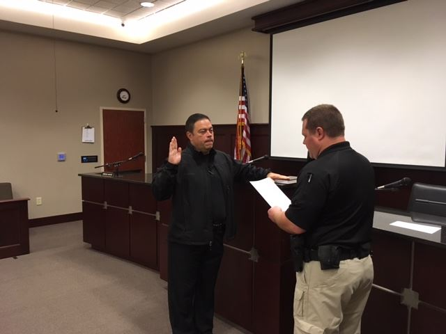 (L-r) Sgt. Bill Finch, Chapin's new Community Services Director, is sworn in by Chief Seth Zeigler.