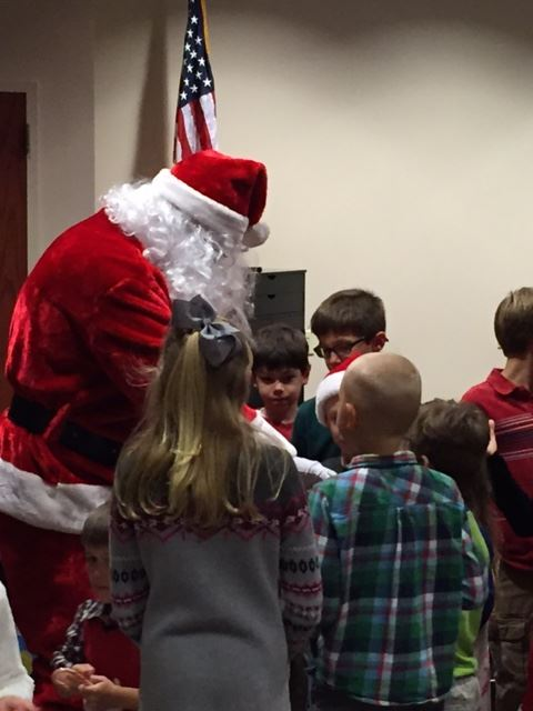 Photo of Santa handing out candy to children