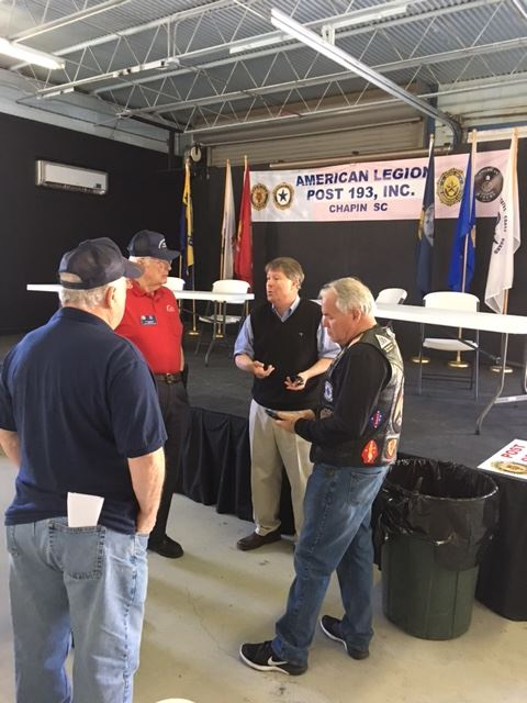 Rep. Chip Huggins chats w Legion members