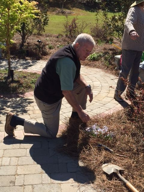 Steve Gladden planting flowers at Town Hall